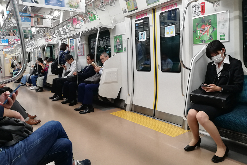 Riding the subway in Tokyo.