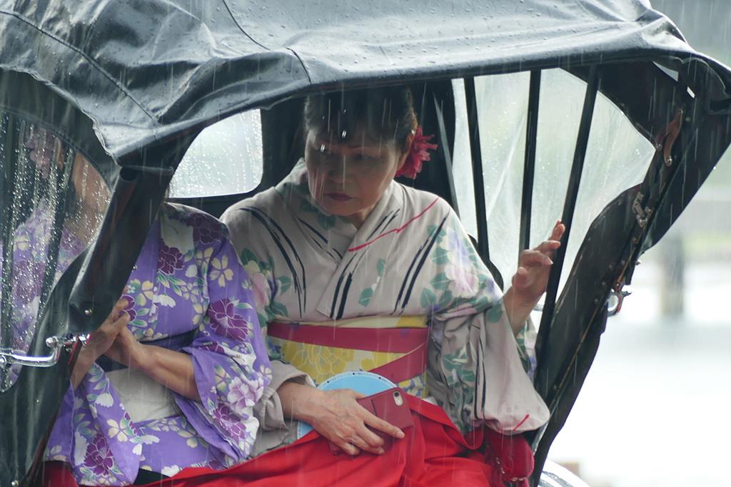 Two Geishas in a Ryksha at Arashiyama, to be visited on 4 Days Kyoto Treasure Box of Japan