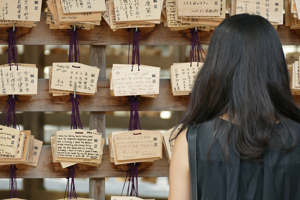 Reading the votive tablets at the Meiji Shrine in Tokyo