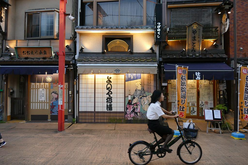 Woman cycling at the Asakusa neighborhood in Tokyo
