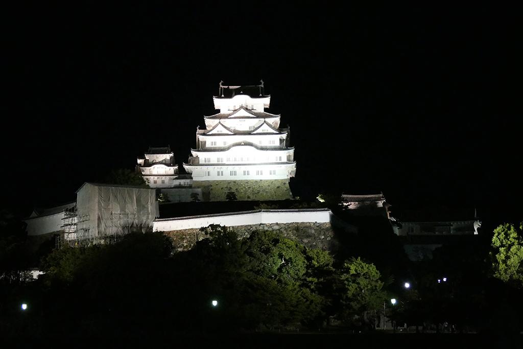 The illuminated Himeji castle at night.