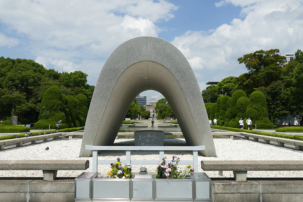 The Memorial Cenotaph is a concrete, arch-shaped structure that covers a tomb holding the names of all those who were killed by the bomb. Built in 1952, it was one of the first memorial monuments in Hiroshima.