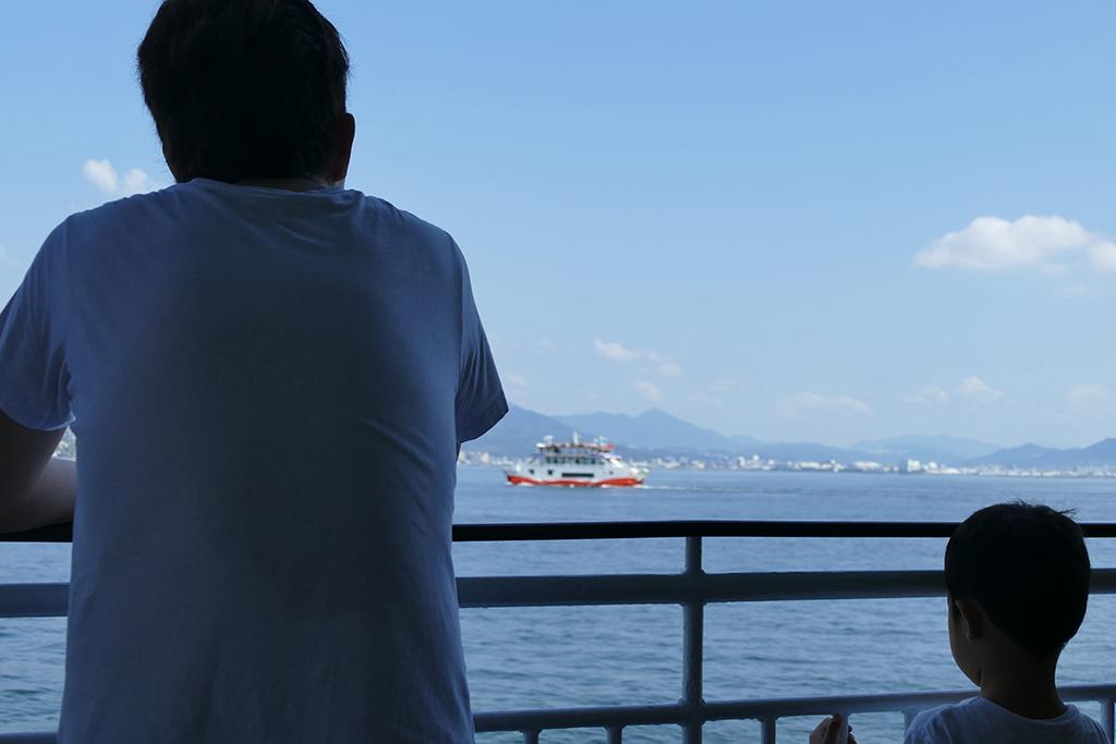 Man and boy on the ferry to Miyajima Island