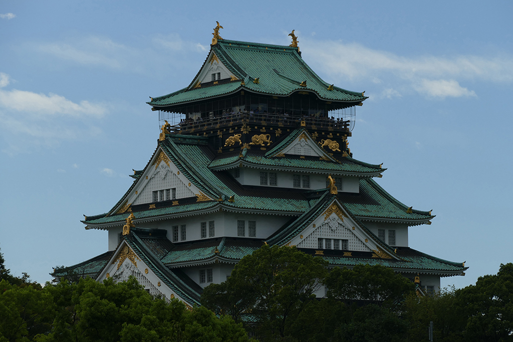 View of the castle in Osaka - you can clearly see the golden lions climbing around on the roof.
