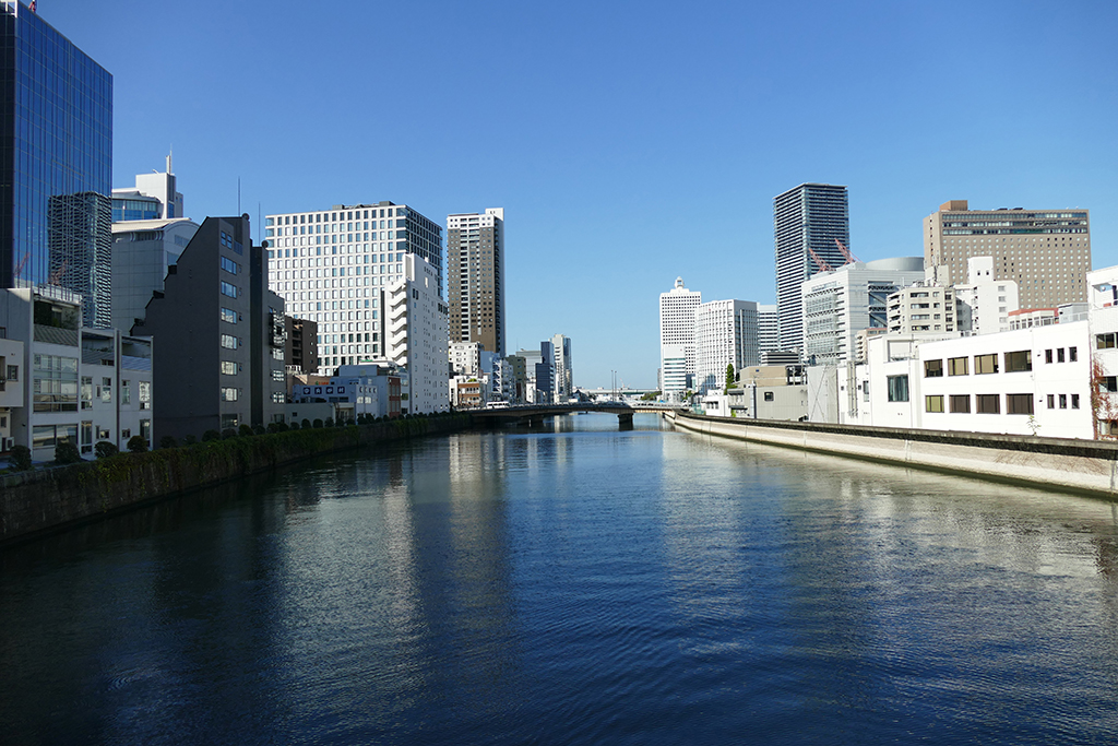 View from the Tamino bridge up the Dojima river, lined with impressive skyscrapers.