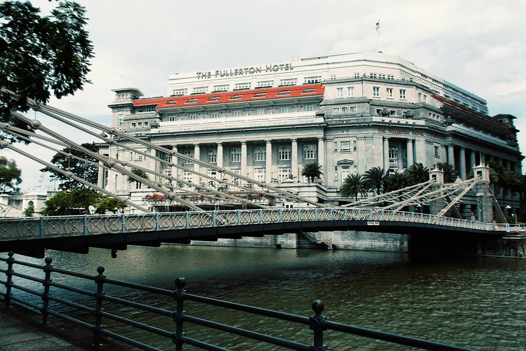 Cavenagh Bridge and The Fullerton Hotel in Singapore