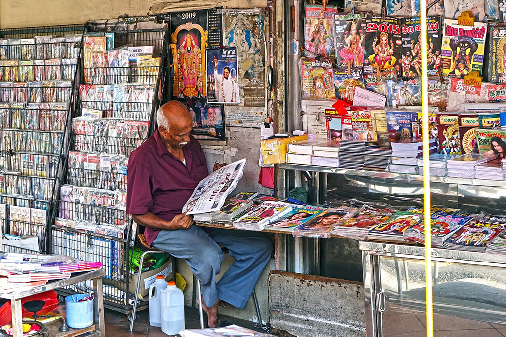 Newspaper vendor in Singapore