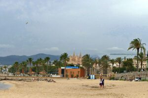Beach at Palma de Mallorca with a view of the city.