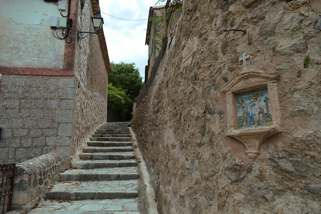 Walking up to Deià's Parròquia Sant Joan Baptista.
