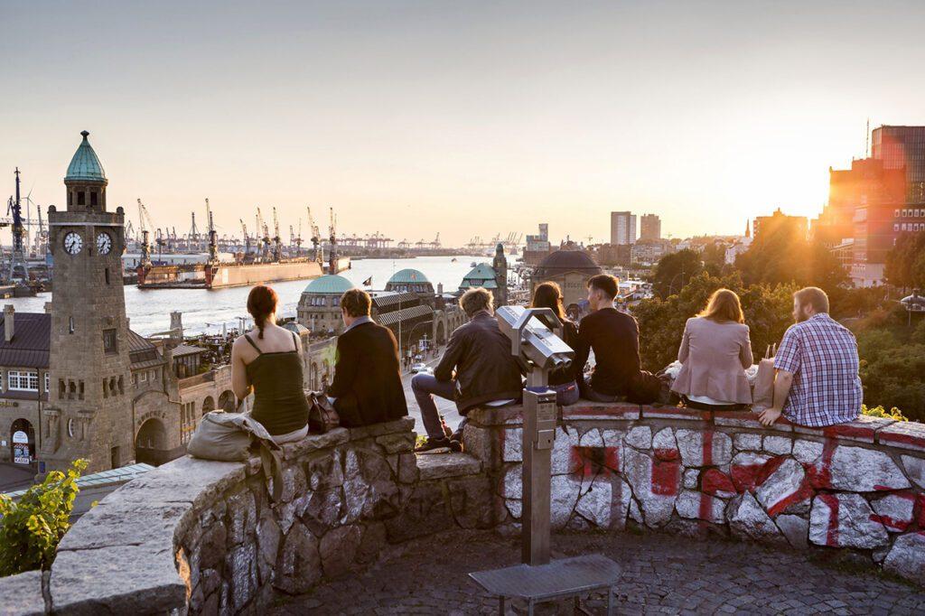 Young People overlooking the Harbor of Hamburg