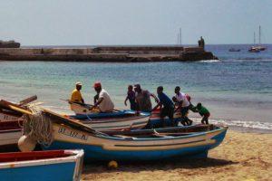 Fishermen pulling boat on shore in Tarrafal, Cape Verde