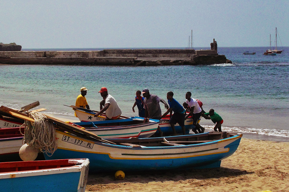 Fishermen pulling boat on shore in Tarrafal, Cape Verde