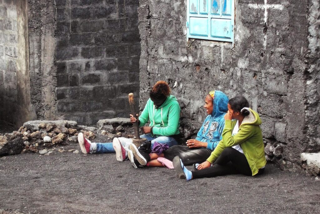 Women Grinding local coffee beans on Fogo