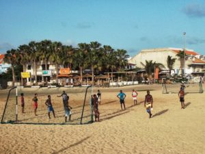Boys playing soccer on the beach of Santa Maria on the island of Sal, Cape Verde