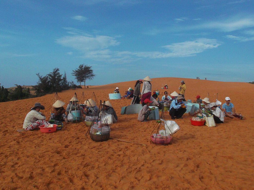 Breakfast vendors on the red dunes of Mui Ne, a place famous for sea and sand