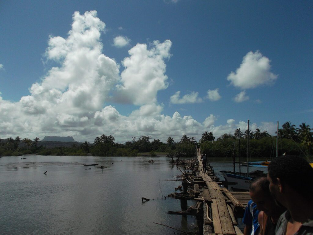 Broken bridge crossing a river near Baracoa