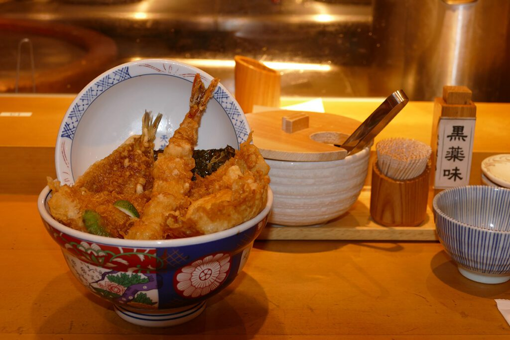 Tempura in Japan: fish and shrimps, veggies and egg in a thin, crispy batter