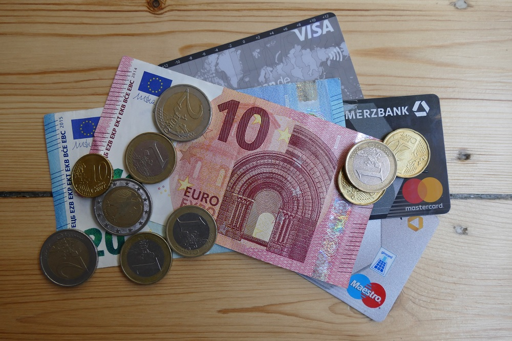 Euro coins and bills as well as credit dards