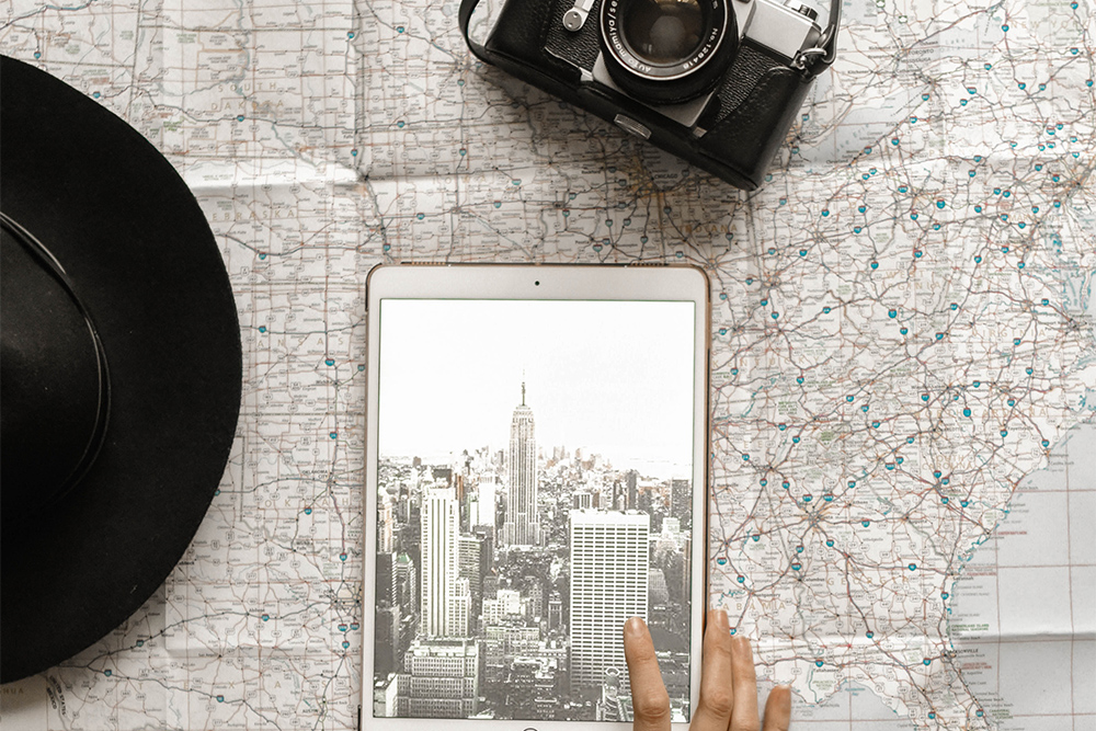 a reader, a camera, and other gadgets on a map