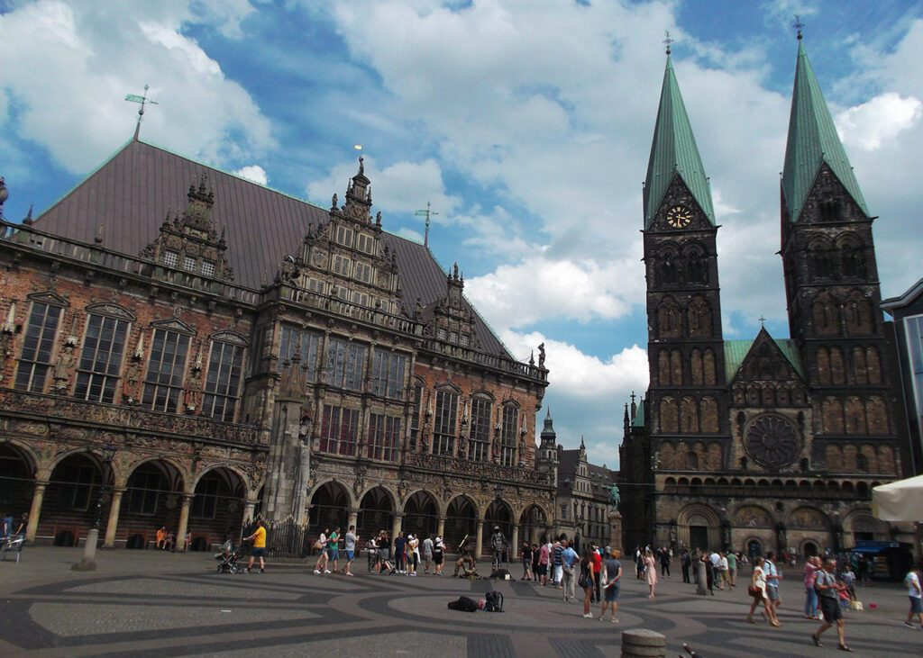 Bremen's old market square with the town hall to the left and the Saint Peter's Cathedral to the right.