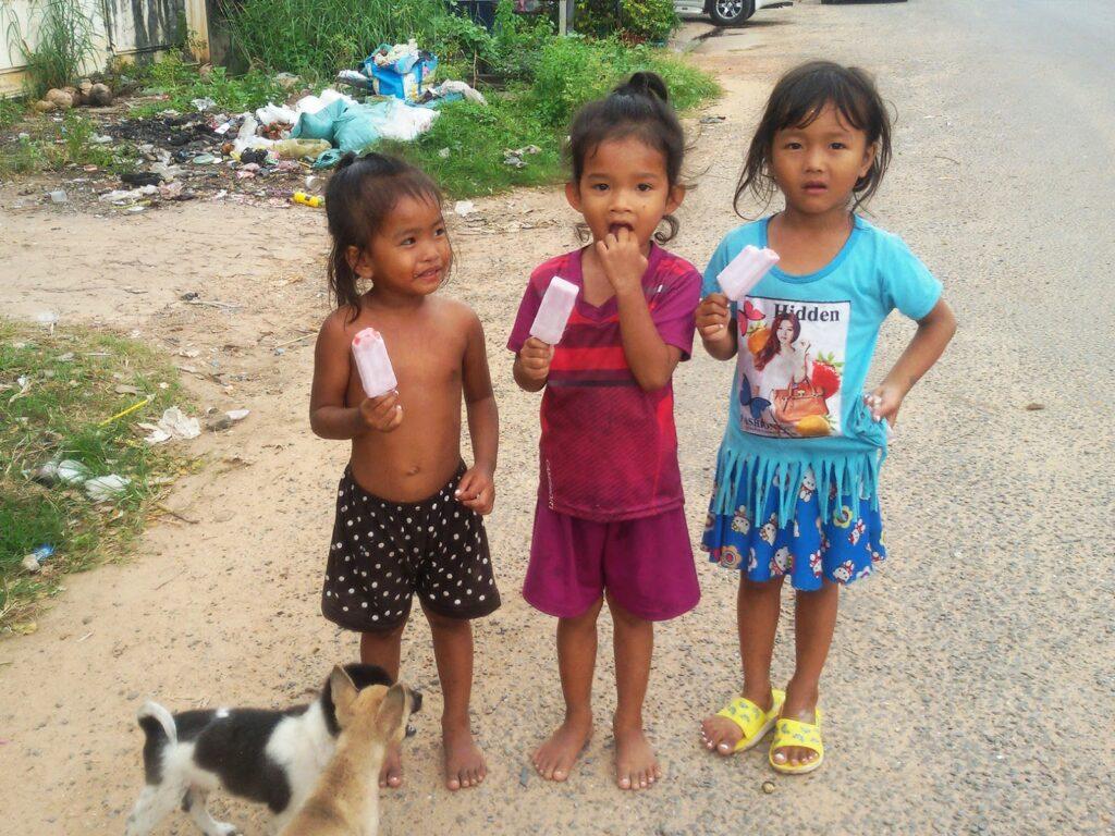 Three little girls on Fish Isle at Kampot