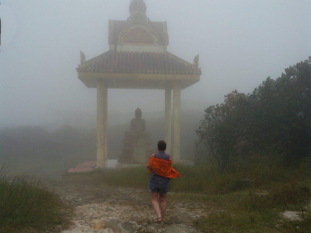 Renata Green on the Thansur Bokor in the mist.