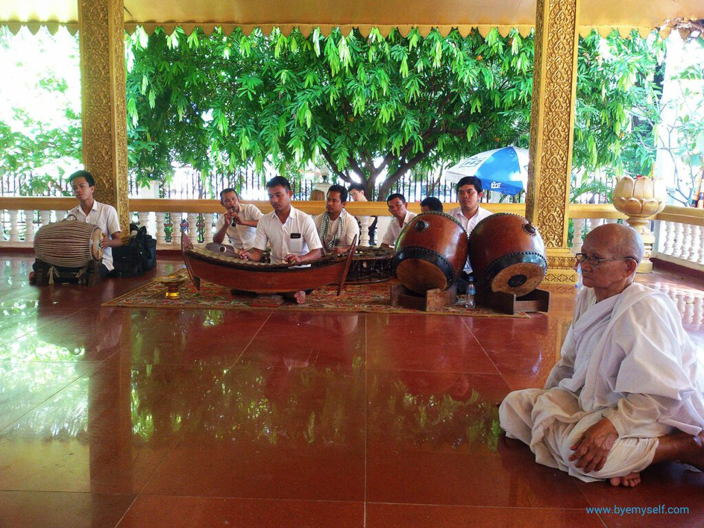 Traditional temple music at Preah Ang Chek - and a Buddhist nun.