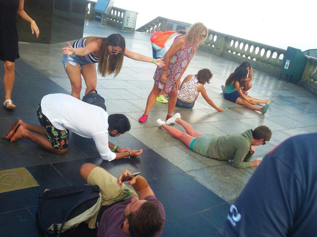 Tourists visiting the Cristo Redentor above Rio de Janeiro, a rough city in Brazil.