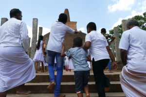 Faithful rushing to the Abayagiri Dagaba in Anuradhapura Sri Lanka