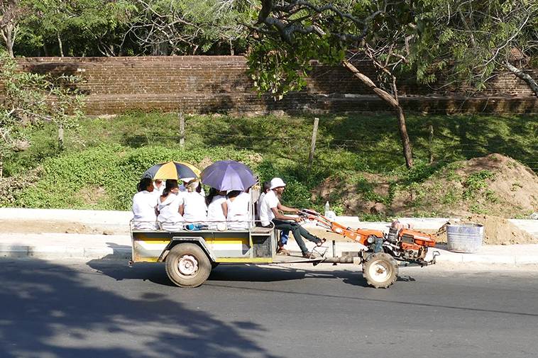 People riding a tractor in Polonnaruwa