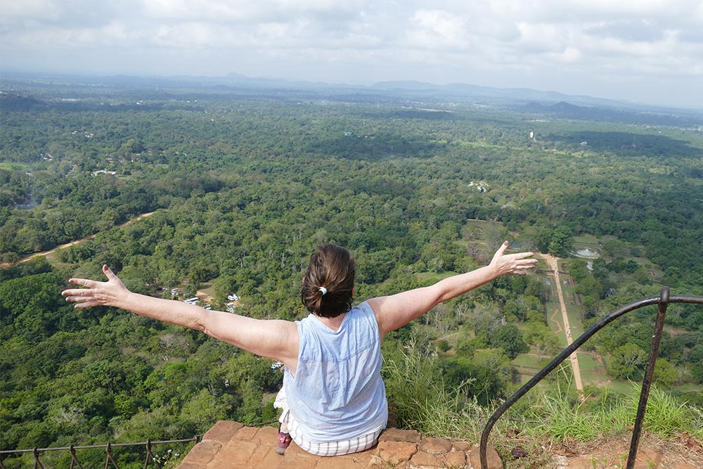 Renata Green sitting on the Lion Rock of Sigiriya before a daytrip to Dambulla