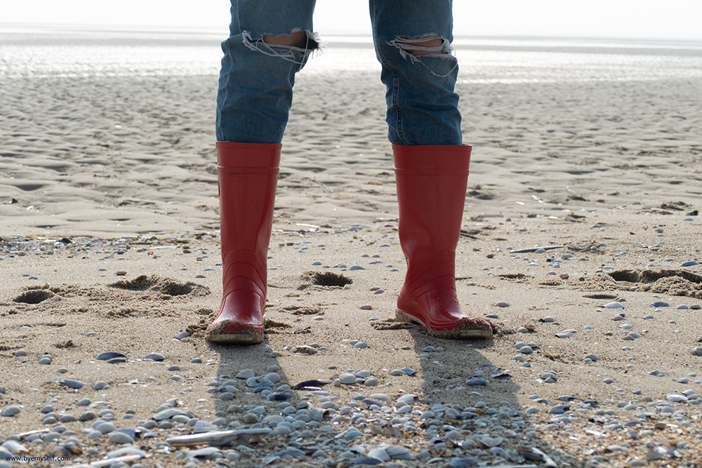 Woman in gumboot on the mudflat