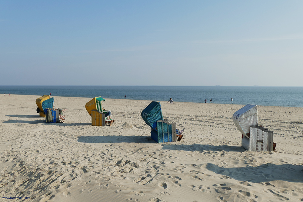 Hooded wicker chairs on the beach of Foehr