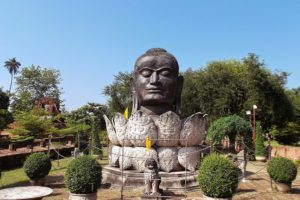 Statue of a Buddha head in a blossom at the city of Ayutthaya, Thailand