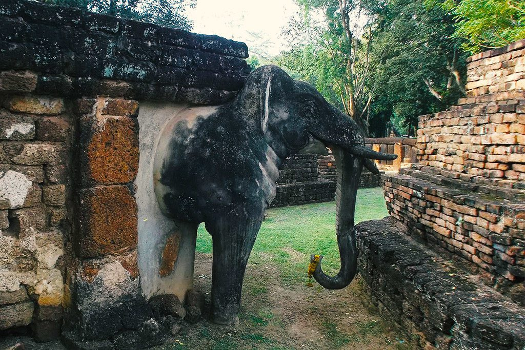 Elephant Statue at the archeological park in the city center of Kamphaeng Phet, Thailand